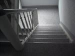 Essen: Innentreppe Holzstufen mit Steinteppich M1003 beschichtet