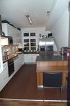 Lünen: Küchenboden mit Steinteppich in RAL 8011 nußbraun